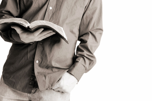 Casually Dressed Christian Man Holding Open Bible Stock Photo - Download Image Now