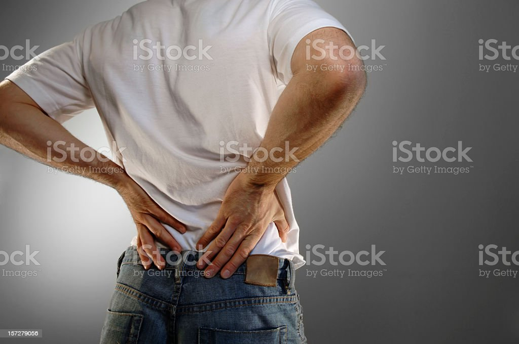 Casually Dressed Man with Back Pain stock photo