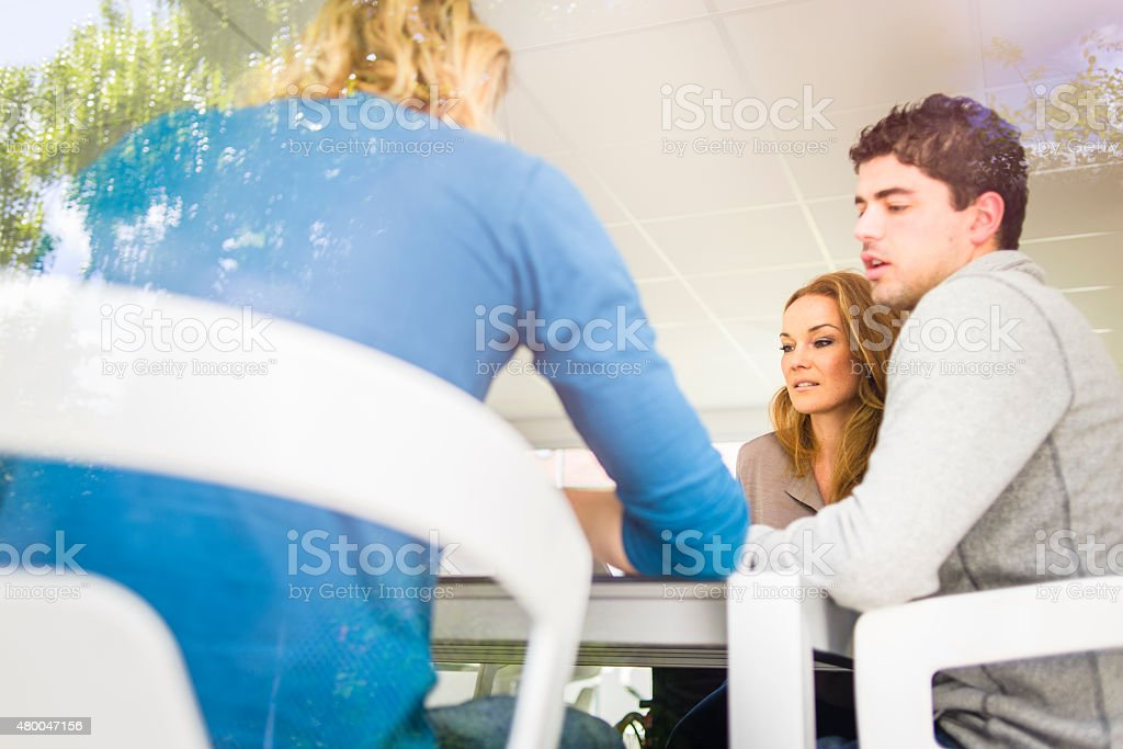 Casually-Dressed Business Team Working Together at Table royalty-free stock photo
