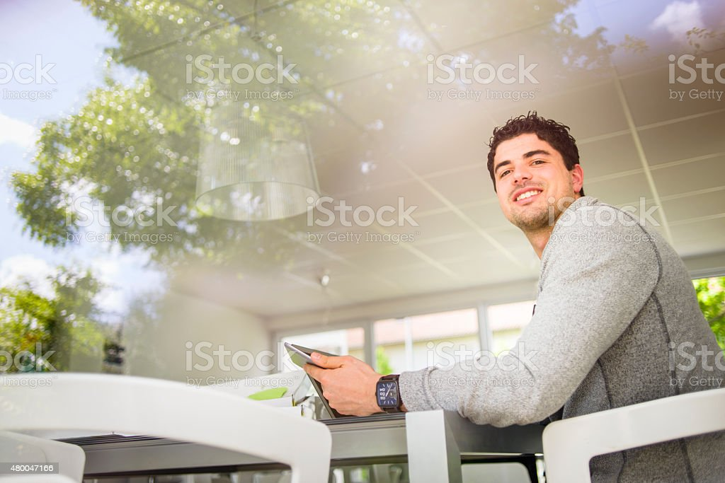 Casually-Dressed Professional Man Working in Office Rest Area royalty-free stock photo