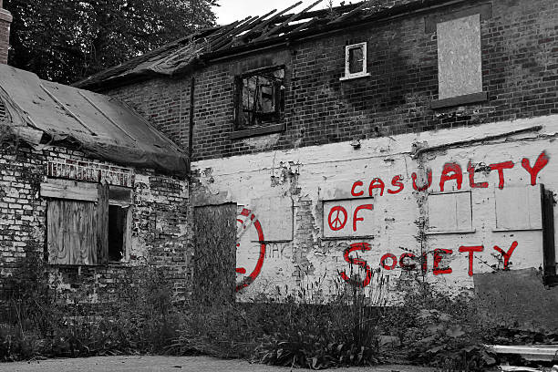 casualty of society bw derelict building, burnt out and left with graffiti abjure stock pictures, royalty-free photos & images