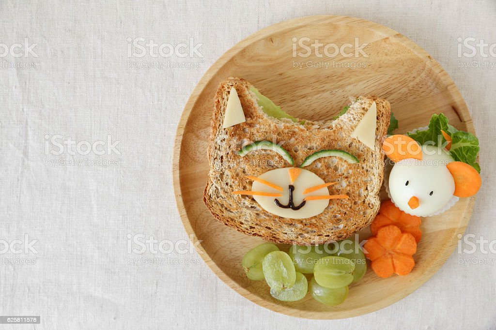 Cat and mouse healthy lunch, fun food art for kids stock photo