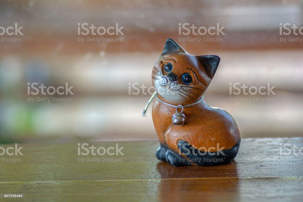 Cat doll made of wood'non the wooden floor stock photo