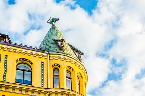Cat House (Kau nams) for two cat sculptures, with arched backs and raised tails, on its roof building in old town of Riga, Latvia.