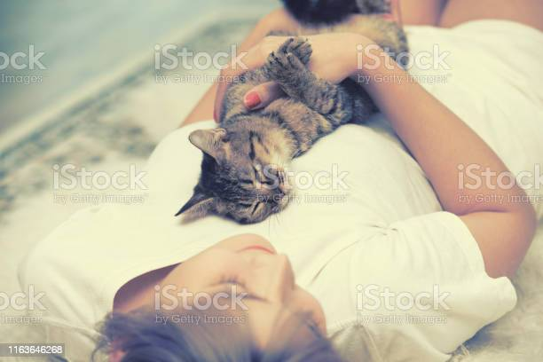 Cat sleep on asian woman chest on carpet picture id1163646268?b=1&k=6&m=1163646268&s=612x612&h=r5cp2avvkpuqiwoelf5fv332 zxyumxag5bkzgnvdrm=