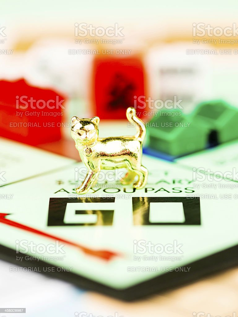 Cat Token on Monopoly Board stock photo