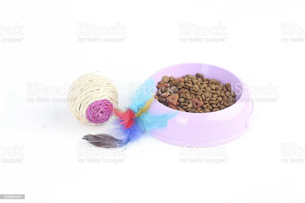 Cat toy with dry cat food in a bowl stock photo