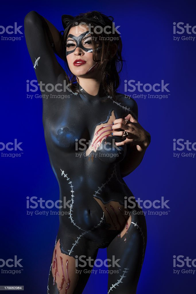 Cat woman: young girl with a feline bodypaint stock photo