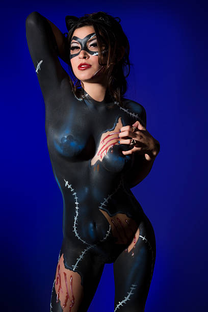 cat woman: young girl with a feline bodypaint - naked women with animals stock photos and pictures