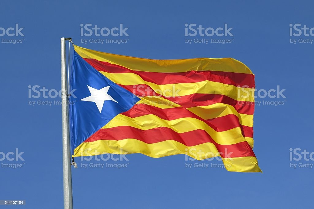 Catalan flag separatist independence flag waves in blue sky stock photo