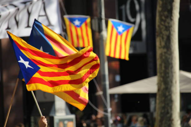 Catalan independentist symbols Barelona, Spain - September 11, 2017: Catalan independentists flags