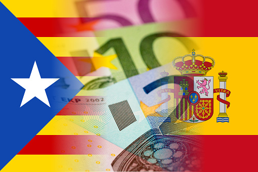 Catalonia And Spain Flags With Euro Banknotes Stock Photo - Download Image Now