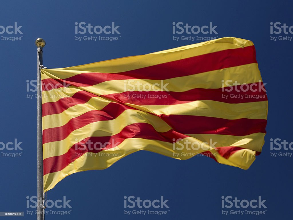 A Catalonia flag on a pole in motion royalty-free stock photo