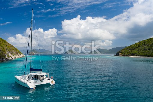 Aerial view of people relaxing on Catamaran at anchor outside of Lavango Cay, United States Virgin Islands