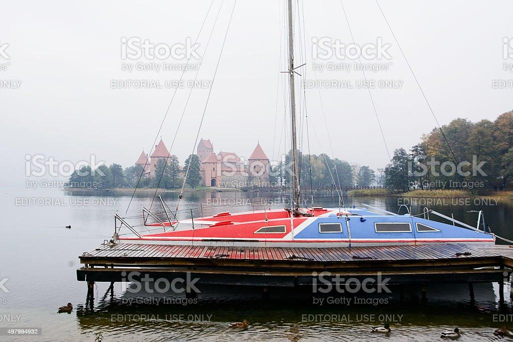 Catamaran and castle in Trakai stock photo