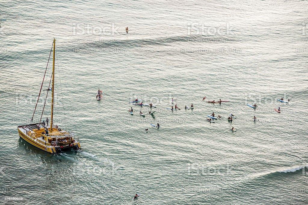 Catamaran and People on paddleboards in ocean, Hawaii stock photo