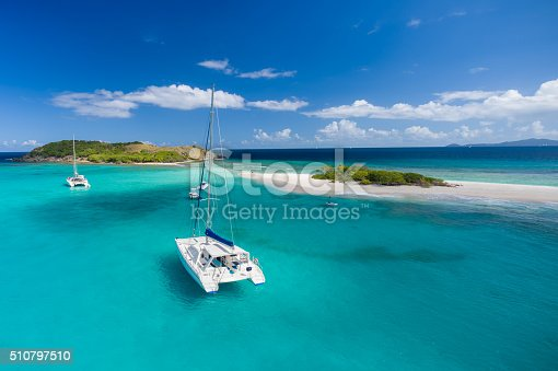 Aerial view of a catamaran at anchor in front of Sandy Spit, British Virgin Islands, Caribbean