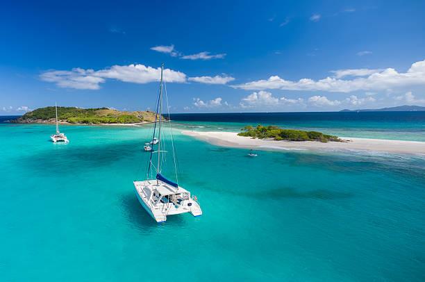 catamaran at anchor in front of deserted island - katamaran bildbanksfoton och bilder