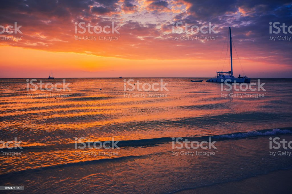 Catamaran at sunset stock photo