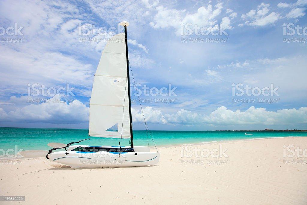 Catamaran at tropical beach stock photo