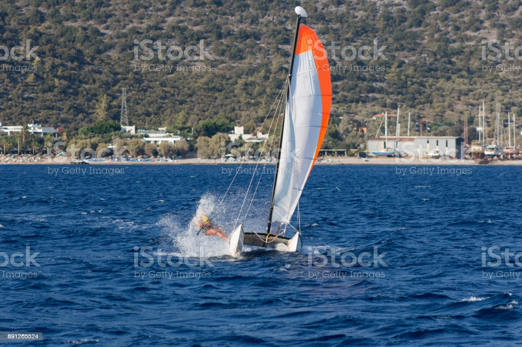 Catamaran sailing surf at horizon of gokova bay in aegean sea near bodrum mugla turkey stock photo