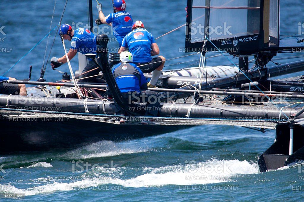 Catamaran Yacht Racing Crew Hard at Work. stock photo