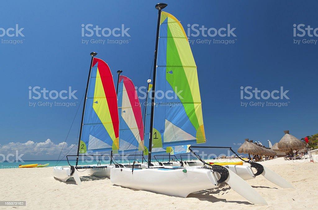 Catamarans on the Caribbean beach royalty-free stock photo