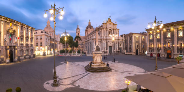 Catania Cathedral at night, Sicily, Italy Panoramic aerial view of Piazza Duomo in Catania with the Cathedral of Santa Agatha and Liotru, symbol of Catania, at night, Sicily, catania stock pictures, royalty-free photos & images