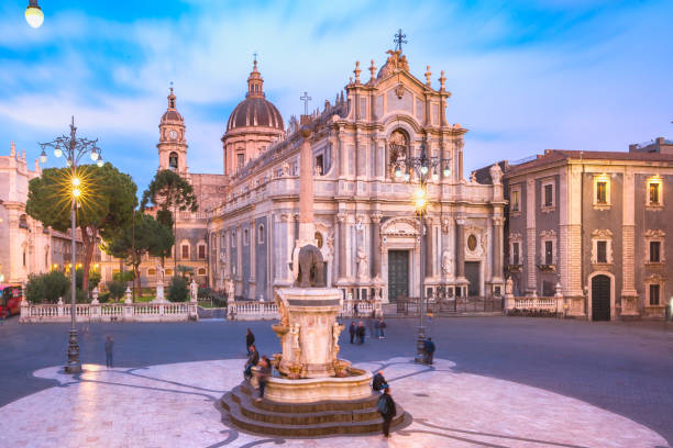 Catania Cathedral at night, Sicily, Italy Piazza Duomo in Catania with the Cathedral of Santa Agatha and Liotru, symbol of Catania in the evening, Sicily, catania stock pictures, royalty-free photos & images
