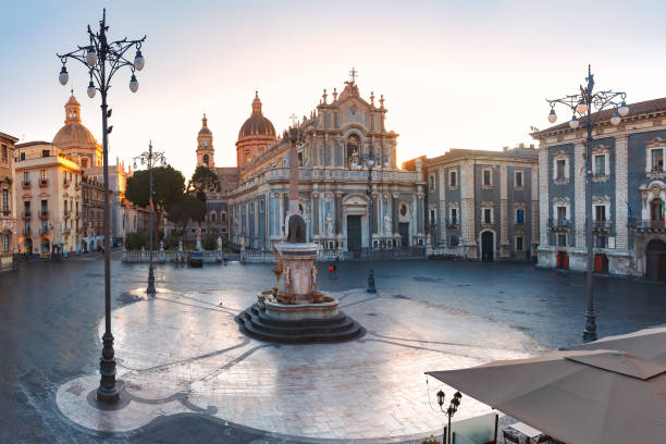 Catania Cathedral at sunrise, Sicily, Italy The first sunray on Piazza Duomo in Catania and the Cathedral of Santa Agatha and Liotru, symbol of Catania at sunrise, Sicily, catania stock pictures, royalty-free photos & images