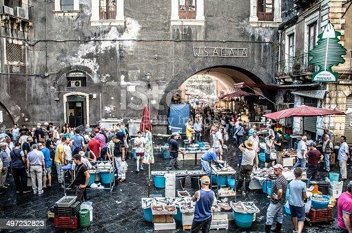 Catania, Italy - July 29, 2013: Old fish market of Catania in the crowded square Alonzo di Benedetto, Sicily