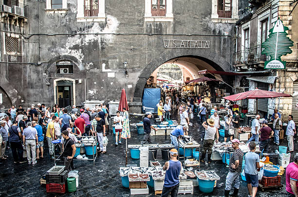 Catania Fish Market Catania, Italy - July 29, 2013: Old fish market of Catania in the crowded square Alonzo di Benedetto, Sicily catania stock pictures, royalty-free photos & images