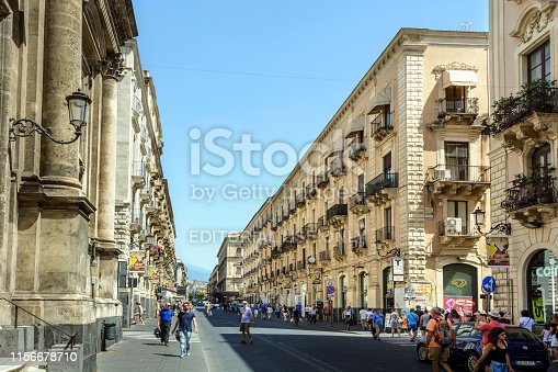 Catania, Sicily, Italy - July 2, 2018: Crowded street in Catania. Busy day in Catania, beautiful city on the east coast of Sicily. Picture taken during a warm summer afternoon.