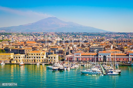 Beautiful view of Catania cruise port with smoking volcano Etna in the background.