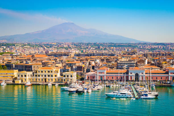 Catania Sicily, Italy Beautiful view of Catania cruise port with smoking volcano Etna in the background. sicily stock pictures, royalty-free photos & images