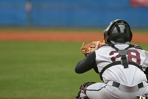 Catcher at a baseball game in position to catch stock photo