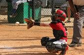 a boy playing catcher