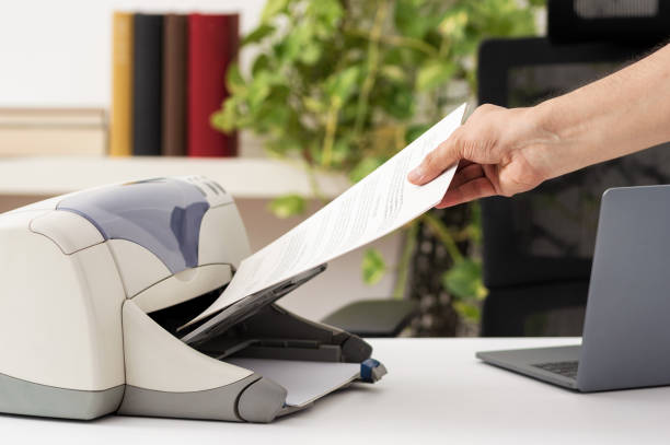 catching a document from a printer stock photo