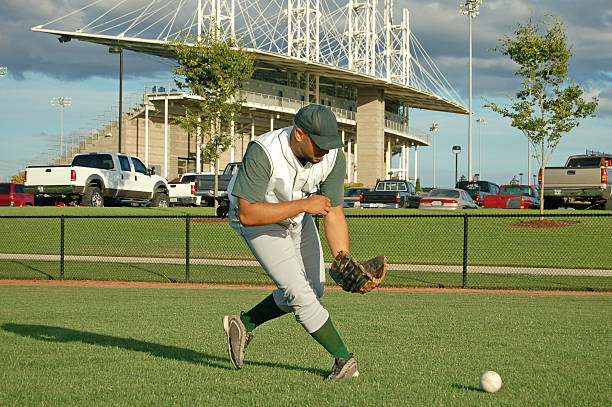 catching a grounder - spring training stock photos and pictures