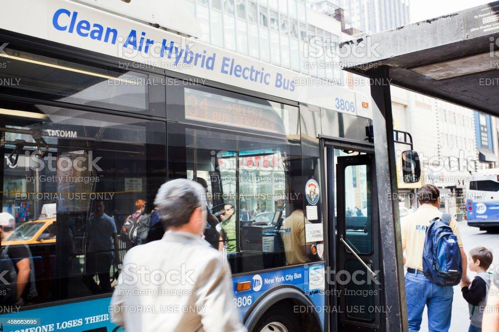 Catching a Hybrid Bus Manhattan stock photo