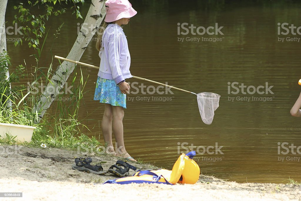 Catching salamanders by the pond royalty-free stock photo