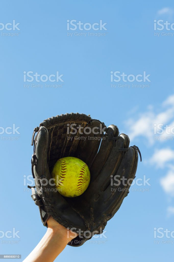 a girl catching a softball