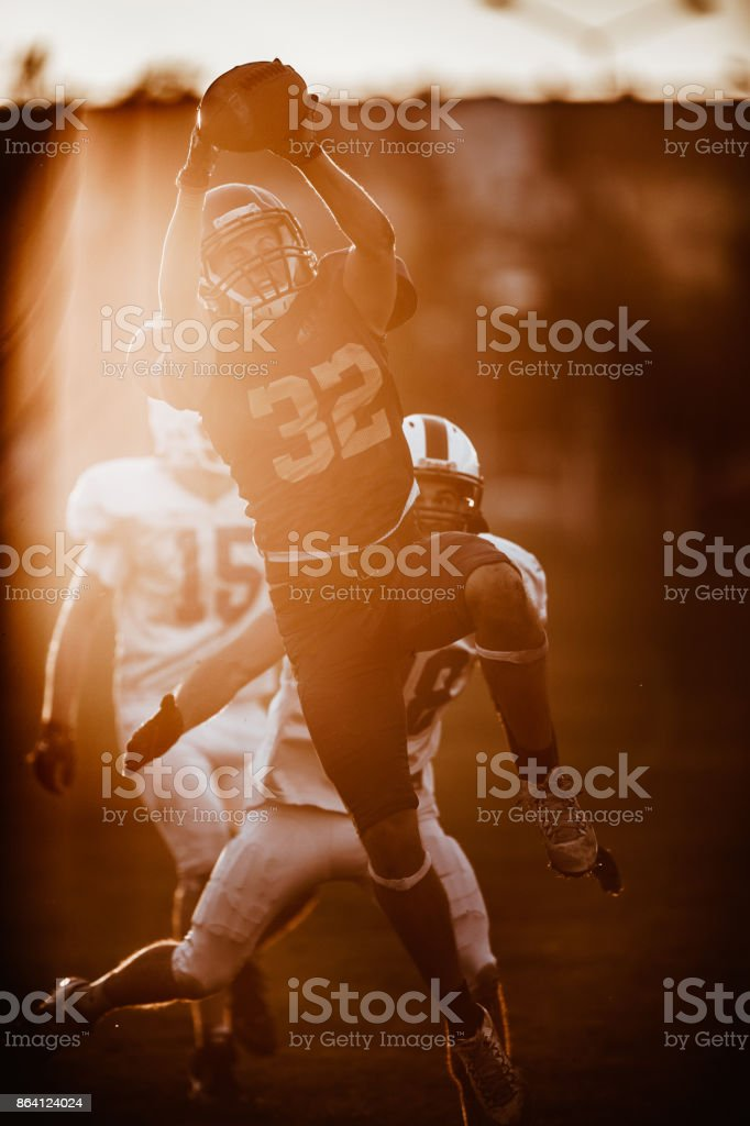 Catching the ball during American football match! royalty-free stock photo