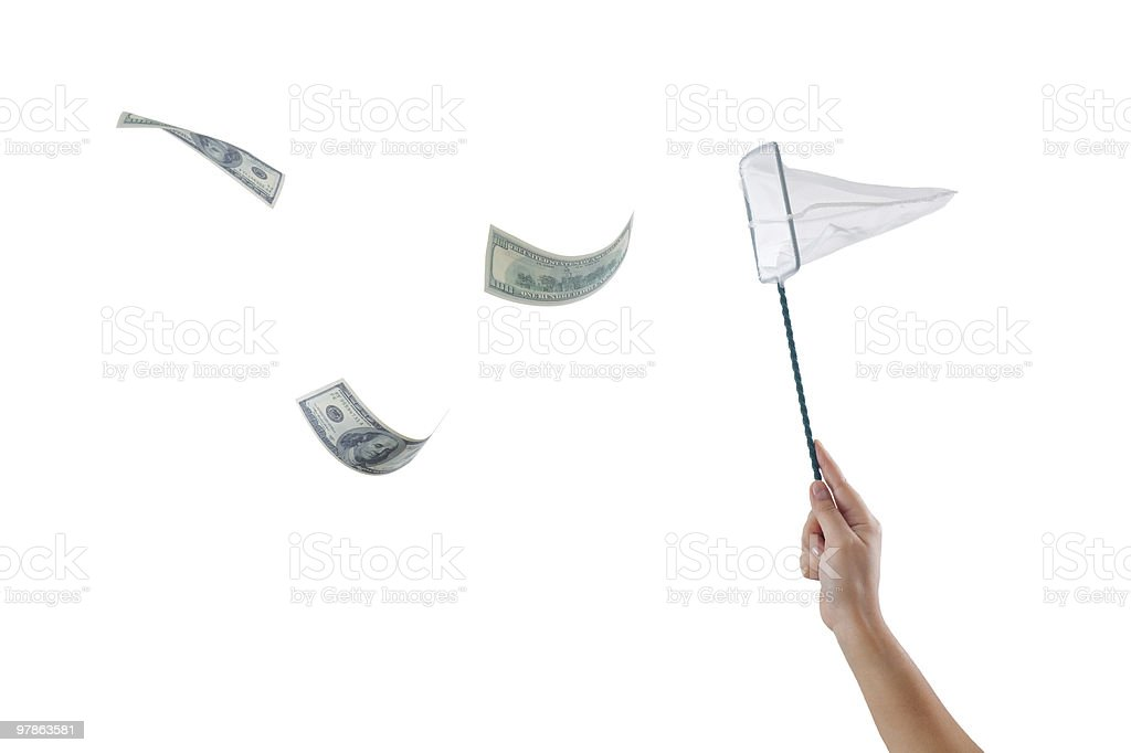 catching the flying dollars with a net stock photo
