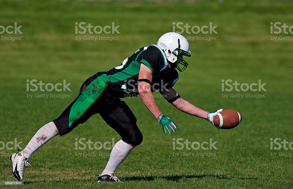 Catching the Football stock photo