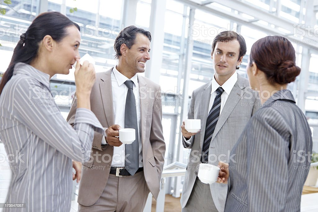 Catching up in the coffee break royalty-free stock photo