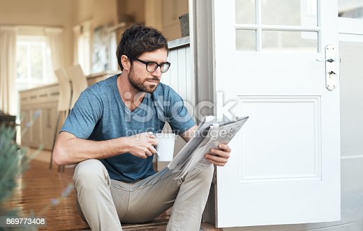istock Catching up on the latest news 869773408