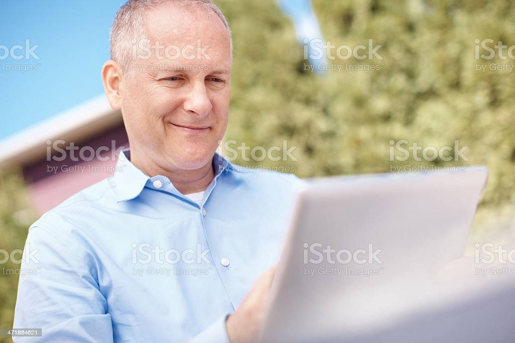 Catching up on the news digitally royalty-free stock photo
