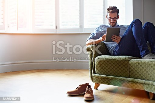istock Catching up with his online reading 643625044