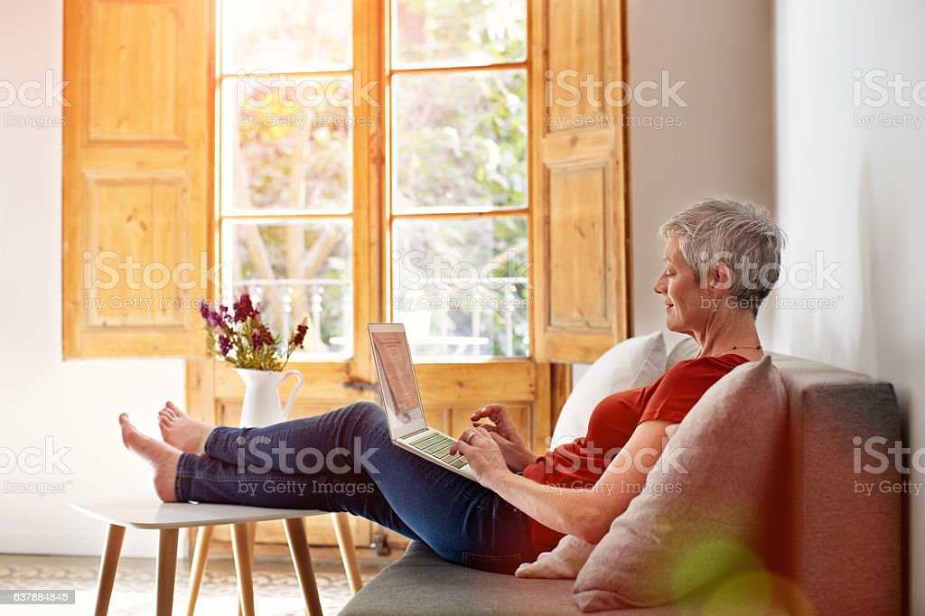 Catching up with online correspondence stock photo